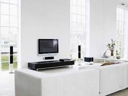 white livingroom modern white living area with black tv sets part of interior