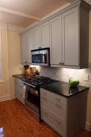 mahogany wood nutmeg raised door painted gray kitchen cabinets