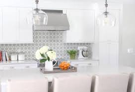 white kitchen with cement tile backsplash and quartz countertops