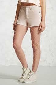 light pink fishnet tights lyst forever 21 fishnet tights in pink
