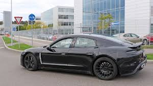 first porsche first porsche mission e spy photos emerge complete with teslas in
