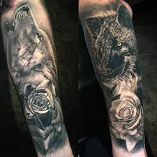 black and grey wolves and roses by locket tattoonow