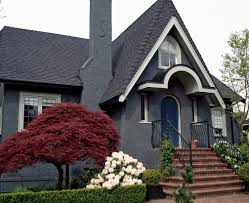 grey blue exterior house color with wrought iron stair railing