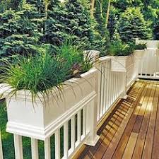 the 24 u0027 charleston rail top planter sits over a railing and can be