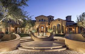 mediterranean luxury home front entry patio courtyard with water