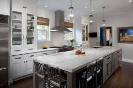pictures of white kitchen cabinets with island transitional white kitchen with grey blue stained island