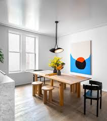 brooklyn apartment gets chic interior design by local studio brightly hued artwork adds further pops of color to the home take a look