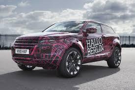 camo range rover rouabas carscoop land rover wraps evoque prototypes in funky