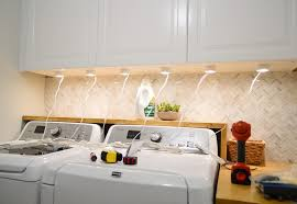 how to put lights above cabinets installing your own cabinet lighting house