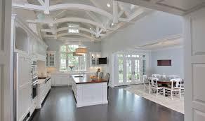 luxury custom white kitchen design with dark wood floor