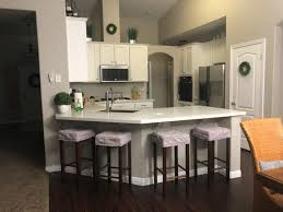 how to install peninsula kitchen cabinets should our peninsula match our cabinets or our walls hometalk