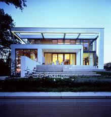 architektur wiesbaden cube on a hillside by dibelius architekten detached houses