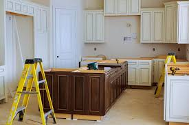 how to make cabinets appear taller why unfinished cabinets are great to in your kitchen