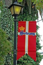 Solvang Inn Cottages by Time To Sit And Gossip As The Bench States Gossip About How