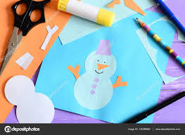 paper card with snowman applique and text i love winter scissors