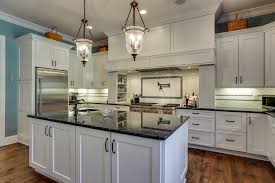 full set of white painted birch kitchen cabinets and granite