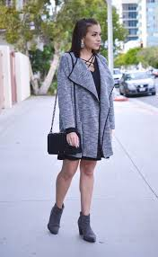 black dress and sweater coat