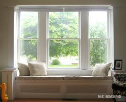 room window square bay seat window cushioned and either with open shelving or