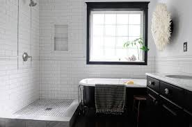 perfect black and white subway bathroom tile in small home