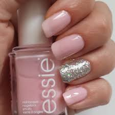 this manicure features light pink and glittered silver nail polish