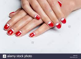 female hands with red and white nails stock photo royalty free