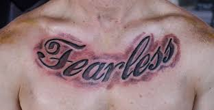 fearless chest lettering tattoo tattoos by mareva lambough