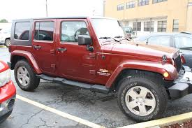 jeep sahara red 2010 jeep wrangler unlimited sahara 4d utility 4wd diminished