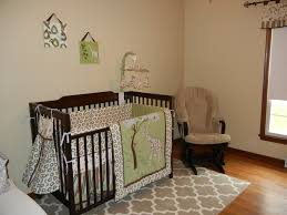 Nursery Room Rocking Chair by White Baby Room Wall Themes With Brown Wooden Cradles And Bedding