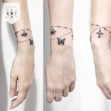 butterfly and cross bracelet designs tattoos