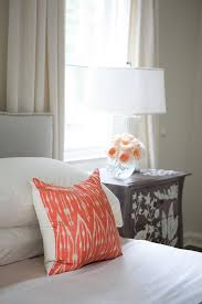 Cream Bedding And Curtains Gray Velvet Camelback Bed With Orange Pillows Transitional Bedroom
