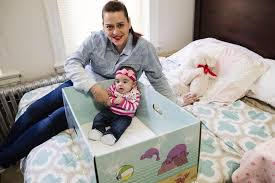 How To Get Your Baby To Sleep In The Crib forget cribs a cardboard box may be the safest place for your