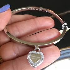 heart charm bangle bracelet images 60 off michael kors jewelry michael kors silver heart charm jpg