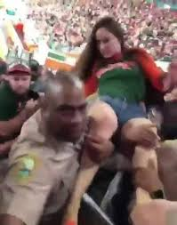 miami fan slaps officer cop who hit drunk woman at miami game cleared of wrongdoing miami