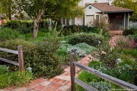deer resistant native plants picket fence and brick path entering front yard california native
