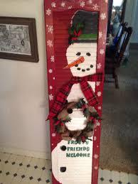 old shutter painted a snowman wreathsbymonica wreathsbymonica