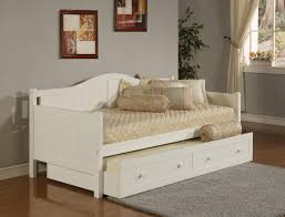 white stained wooden single daybed with trundle using light brown