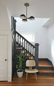 black staircase painted staircases black vs white bright green door