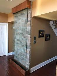 Interior Waterfall Residential Stone Wall Behind Glass Water Wall For An Indoor