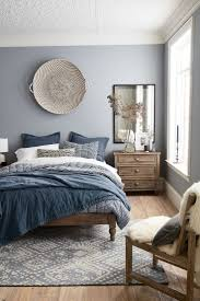 brown wooden floor with blue carpet brown wooden bed blue and