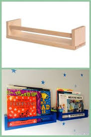 ikea kura bed with upcycled spice rack as book shelves and