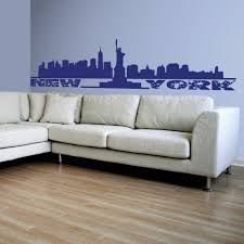 new york skyline and the statue of liberty wall stickers decals blue new york skyline and the statue of liberty wall decal behind a sofa