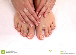 beautiful feet with perfect spa french nail pedicure stock photo