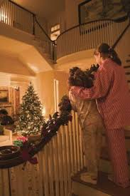 Christmas Lights For Stair Banisters How To Hang Christmas Garland On Your Staircase Home Guides Sf