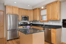 what color cabinets match black granite backsplash rec oak cabinets with granite counters