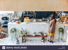 woman waiting rear view coffee shop bar counter concept stock