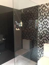 black coloured glass splashbacks in shower bathroom glass