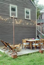 Diy Patio Lights Diy Outdoor Bistro Light Stands For Your Patio Curbly