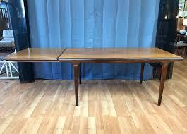 Teal Dining Table by Johannes Andersen For Uldum Extendable Walnut U0026 Teak Dining Table