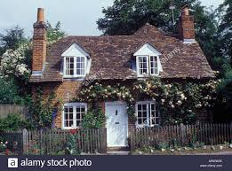 traditional brick country cottage with dormer windows tile roof