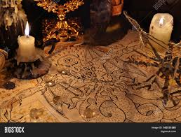 halloween text symbols close up of demon parchment magic objects and candles halloween